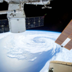 satellite orbiting earth hurricane
